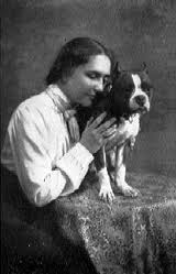 Helen Keller and her pit.  Source.