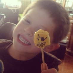 My adorable nephew enjoying his Oreo balls (shaped as lego heads on a stick --- a sort of fail on my part that I may one day tell you about).